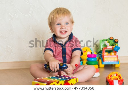 Little 15 yearold baby boy playing stock photo 507493048 portrait of a beautiful baby boy on the floor with car toys 15 negle Image collections