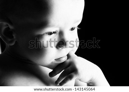 Portrait of a beautiful baby. Over black background. - stock photo