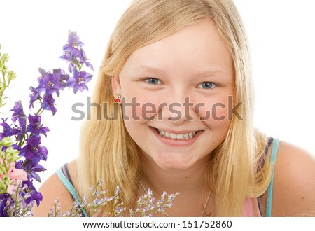 Portrait of a beautiful blond, blue-eyed teenage girl with flowers, on a white background.   - stock photo