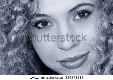 Portrait of a beautiful blond smiling woman