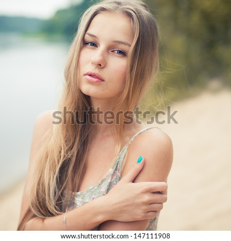 portrait of a beautiful blonde - stock photo