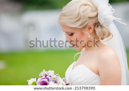 portrait of a beautiful blonde bride. - stock photo