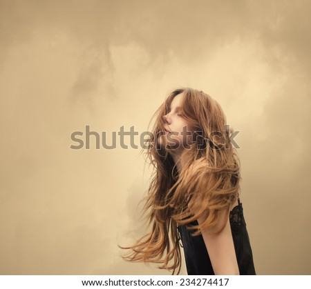 portrait of a beautiful blonde carefree on a windy day