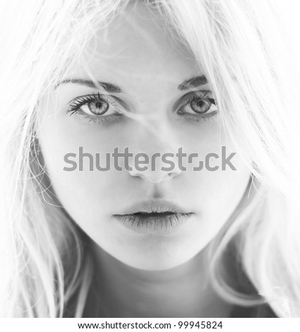 Portrait of a beautiful blonde closeup. Black and white photo - stock photo