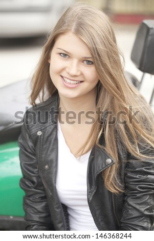 Portrait of a beautiful blonde girl in a leather jacket - stock photo