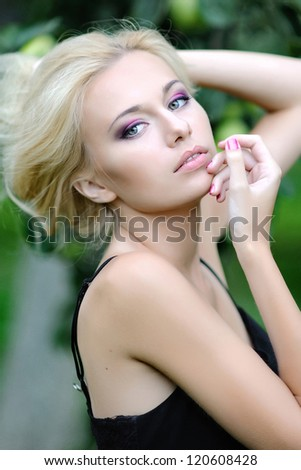 portrait of a beautiful blonde girl outdoors in summer - stock photo