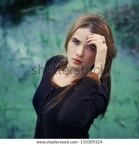 portrait of a beautiful blonde in the park during the summer - stock photo