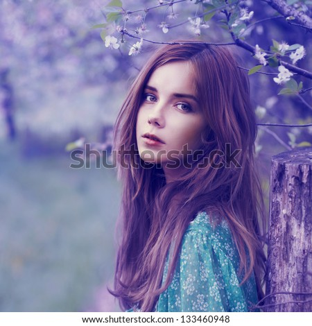 portrait of a beautiful blonde in the spring - stock photo