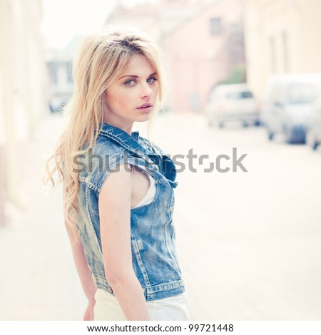 Portrait of a beautiful blonde on the street - stock photo