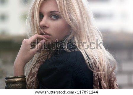 portrait of a beautiful blonde outdoor on the street - stock photo
