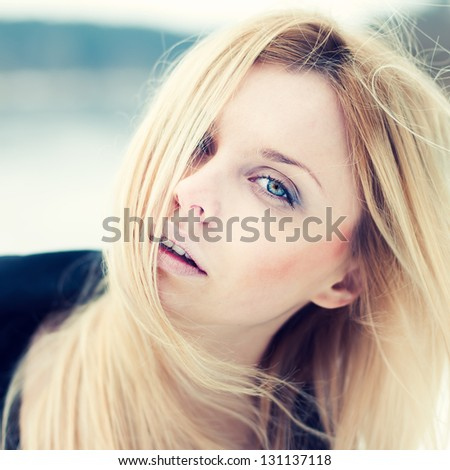 portrait of a beautiful blonde outdoors - stock photo