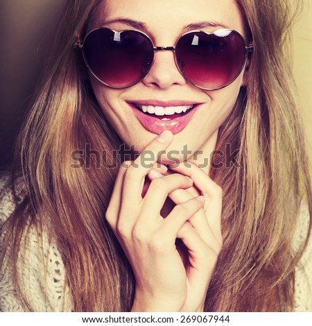 portrait of a beautiful blonde with perfect skin in sunglasses - stock photo