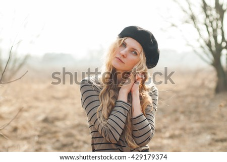 portrait of a beautiful blonde woman in a beret in the French style