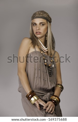 Portrait of a beautiful blonde woman in a bohemian styled outfit