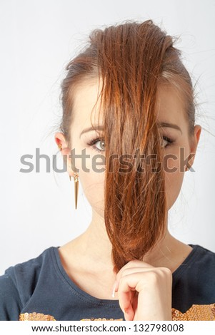 portrait of a beautiful blonde woman with a hair before face on white background. - stock photo