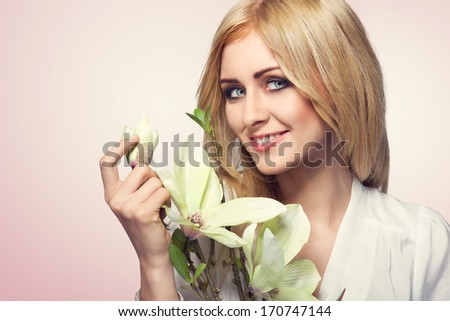 Portrait of a beautiful blonde woman with flowers. Fashion photo