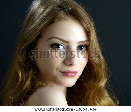 portrait of a beautiful blonde young woman in studio - stock photo