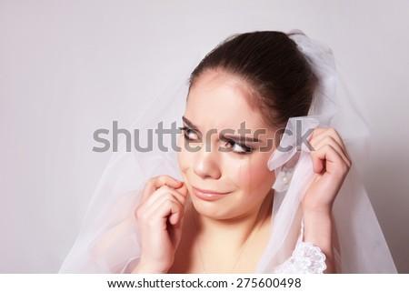 Portrait of a beautiful bride crying hurt closeup - stock photo