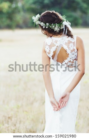 Portrait of a beautiful bride outdoors - stock photo