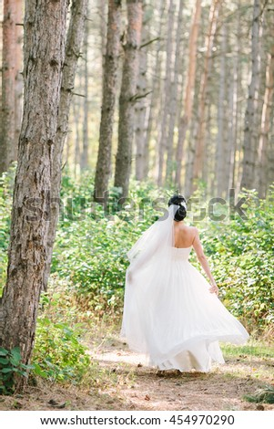 Portrait of a beautiful bride outdoors. Beautiful women in a wedding dress. - stock photo