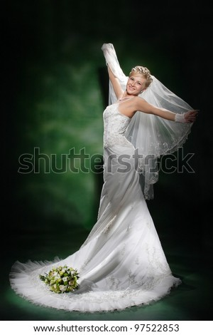 portrait of a beautiful bride with a bouquet of flowers - stock photo