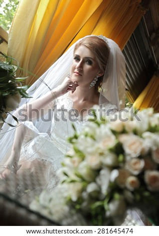 portrait of a beautiful bride with a fragrant cup of coffee. taste of coffee. beautiful look. - stock photo
