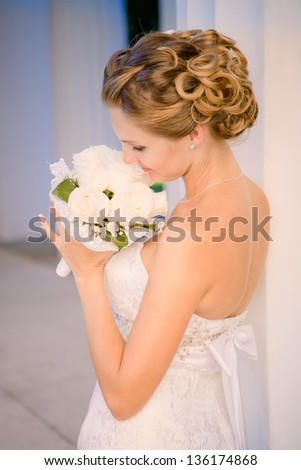 Portrait of a beautiful bride with wedding hairstyle - stock photo