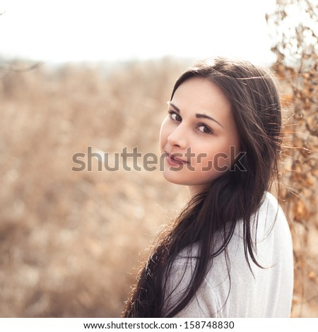 portrait of a beautiful brunette - stock photo