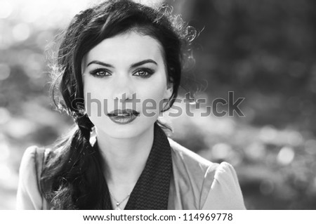 portrait of a beautiful brunette. black and white photo - stock photo