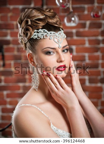 portrait of a beautiful brunette bride.make-up, hairstyle, jewelry.