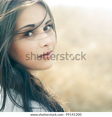 portrait of a beautiful brunette close-up - stock photo