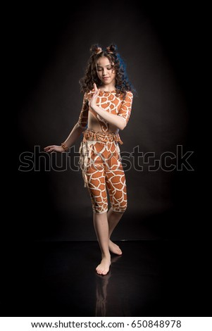 Portrait of a beautiful brunette girl in an orange suit for performing on stage