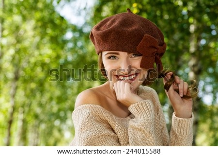 Portrait of a beautiful brunette girl in brown takes, outdoor, closeup - stock photo