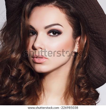portrait of a beautiful brunette girl in the studio - stock photo