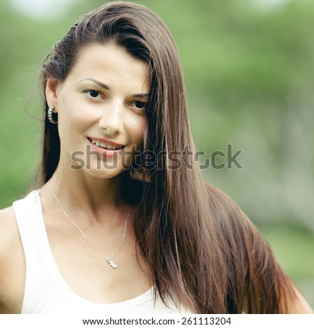 portrait of a beautiful brunette girl outdoor at the day time - stock photo