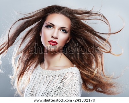Portrait of a beautiful brunette girl with fluttering hair