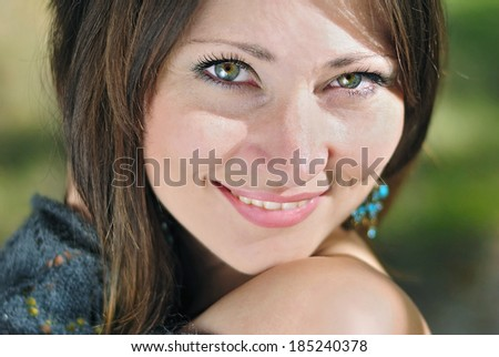 portrait of a beautiful brunette girl with green eyes