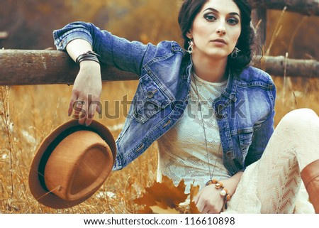 portrait of a beautiful brunette in autumn park