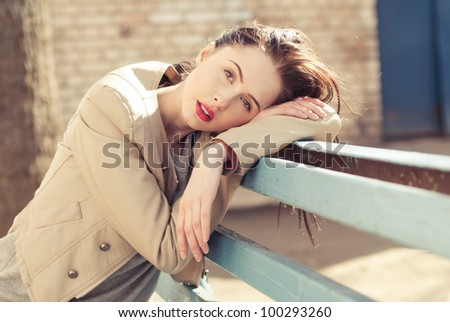portrait of a beautiful brunette waiting - stock photo