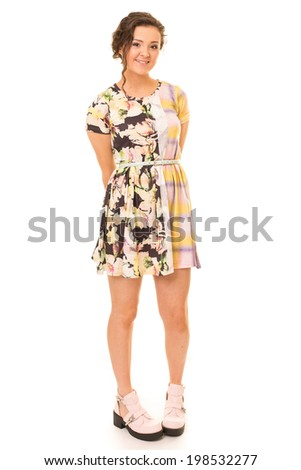 Portrait of a beautiful brunette woman in a colourful dress isolated against a white background