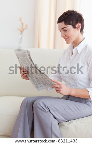 Portrait of a Beautiful brunette woman reading the news in the living room