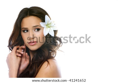 Portrait of a beautiful brunette woman with a white lilly