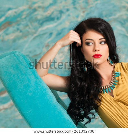 Portrait of a beautiful brunette woman with long creative hairstyle - stock photo