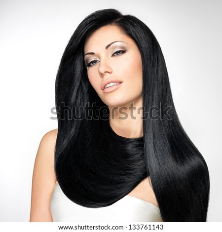 Portrait of a beautiful brunette woman with long straight hairs