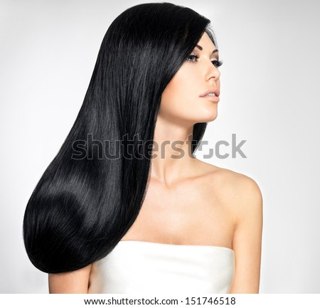 Portrait of a beautiful brunette woman with long straight hairs  - stock photo