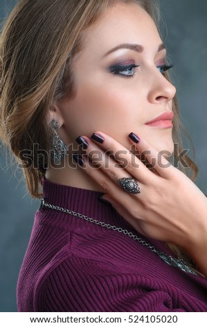 portrait of a beautiful brunette woman with luxury accessories.