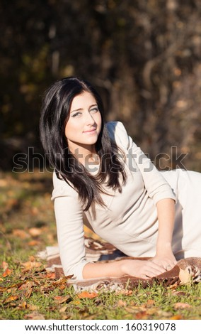 Portrait of a beautiful brunette young woman outdoors