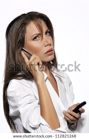 Portrait of a beautiful business woman talking on mobile phone - stock photo
