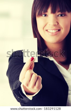 Portrait of a beautiful businesswoman holding a white card.  - stock photo