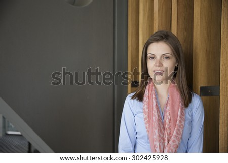 Portrait of a beautiful businesswoman in smart business suit. Caucasian business woman standing outside in modern city.